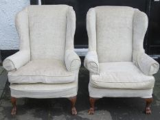 Pair of early to mid 20th century upholstered wing armchairs, on carved supports. Approx. 105cm High