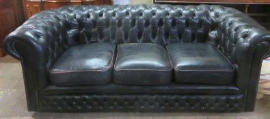 20th century upholstered Chesterfield style button back three seater settee. Approx. 69cm H x