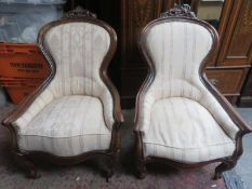 Pair of Victorian mahogany framed upholstered easy chairs, with carved decoration
