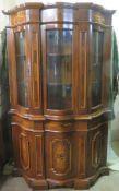 20th century inlaid mahogany Italian style serpentine fronted three door glazed display cabinet.
