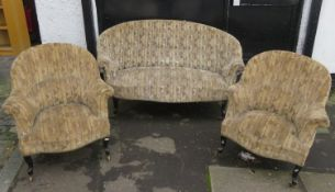 Victorian geometric upholstered salon settee, with pair of matching easy chairs, all on ebonised
