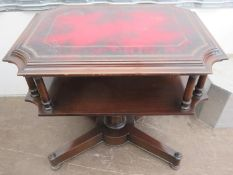 20th century mahogany two tier side table, with oxblood leather effect top, on quadrafoil