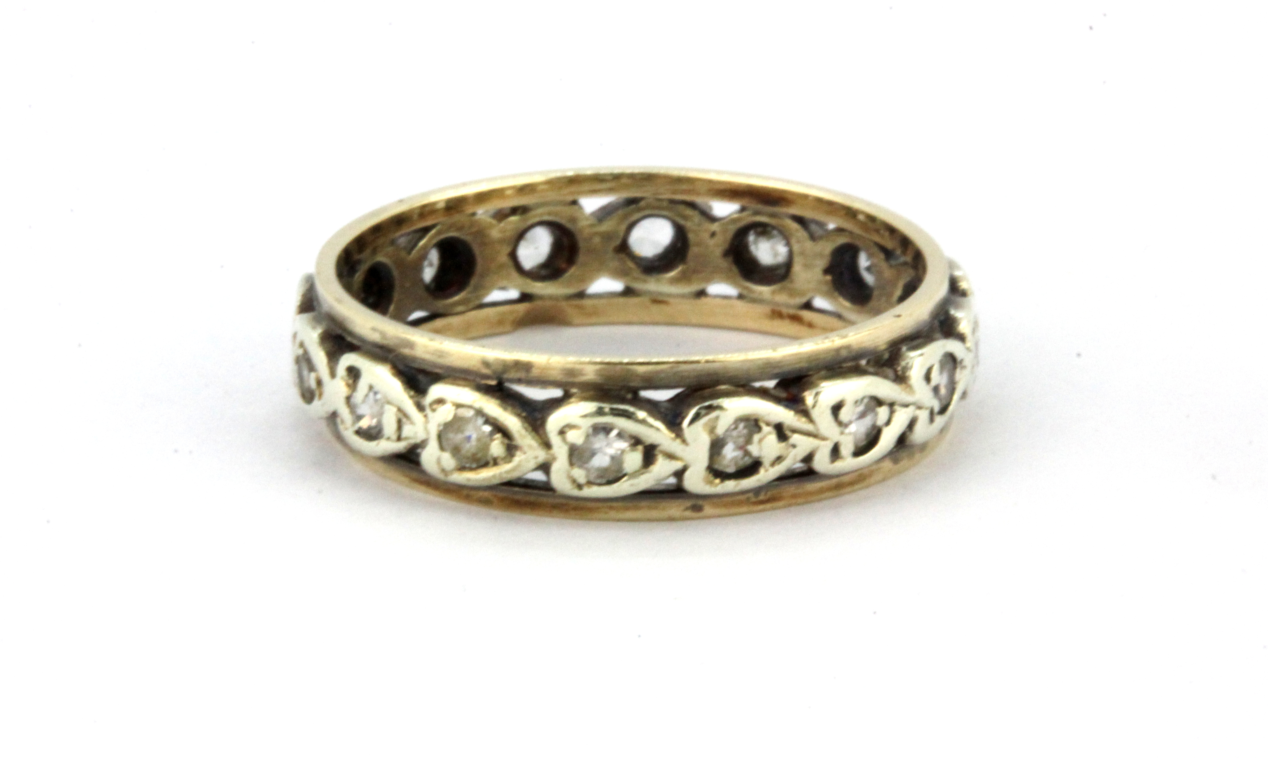 Lot 88 - A 9ct yellow and white gold stone set full eternity ring, (N.5).