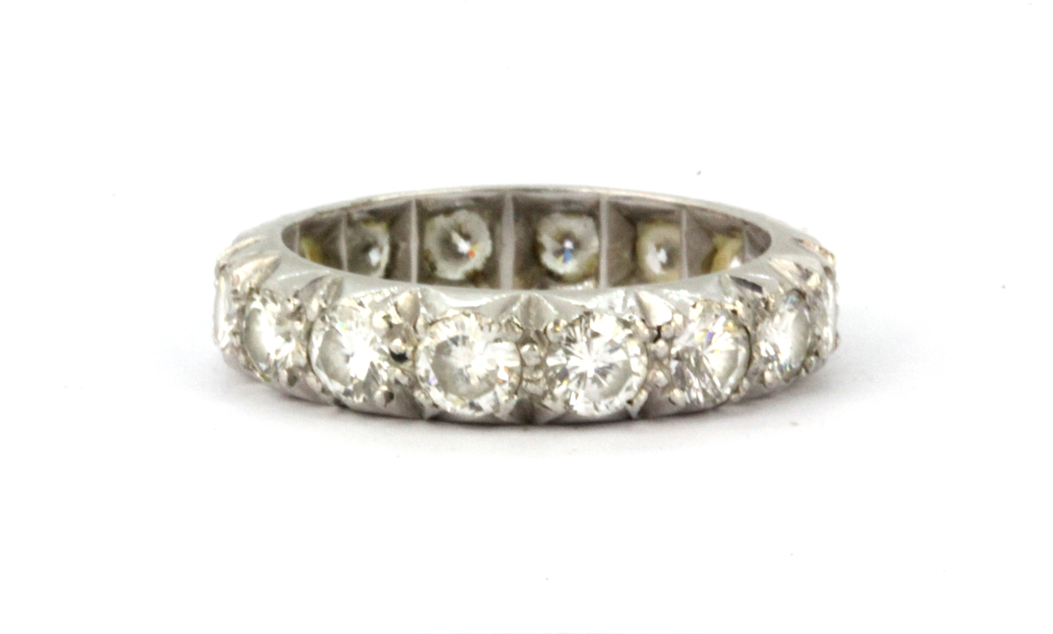 Lot 119 - A white metal (tested high carat gold) full eternity ring set with brilliant cut diamonds, approx.