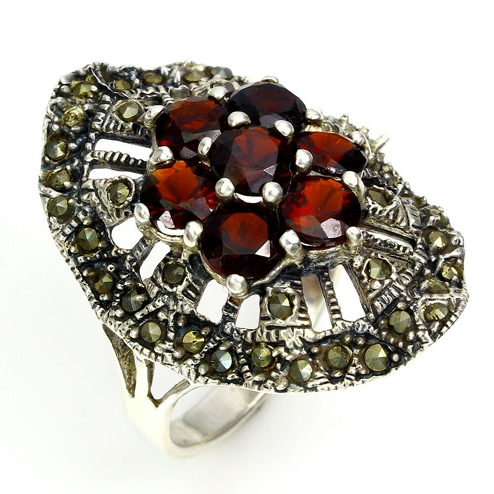 A 925 silver and marcasite ring set with garnets, (R). - Image 3 of 3
