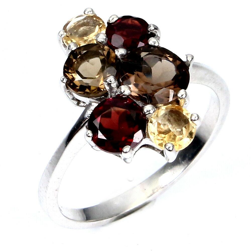 A 925 silver ring set with smokey quartz, citrine and garnets, (O). - Image 2 of 2