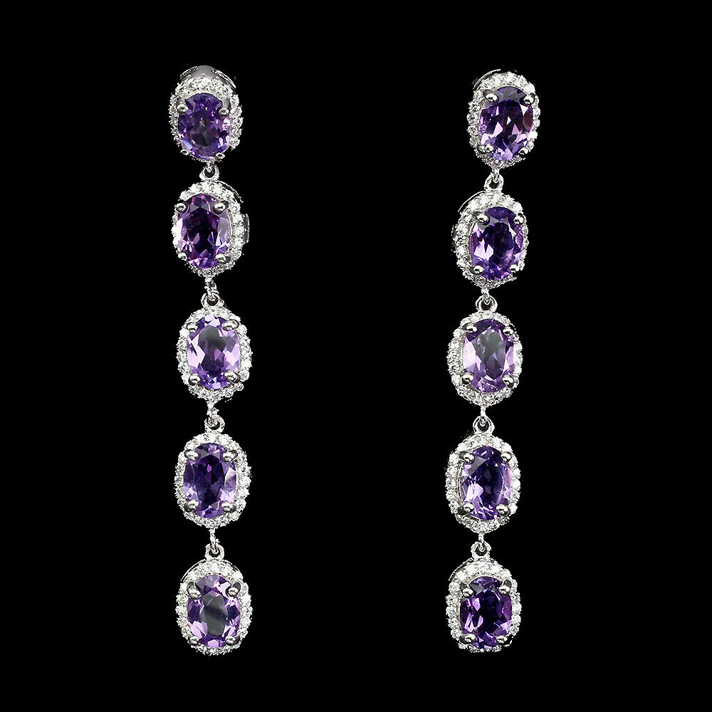 Lot 53 - A pair of 925 silver drop earrings set with oval cut amethysts and white stones, L. 5.5cm.