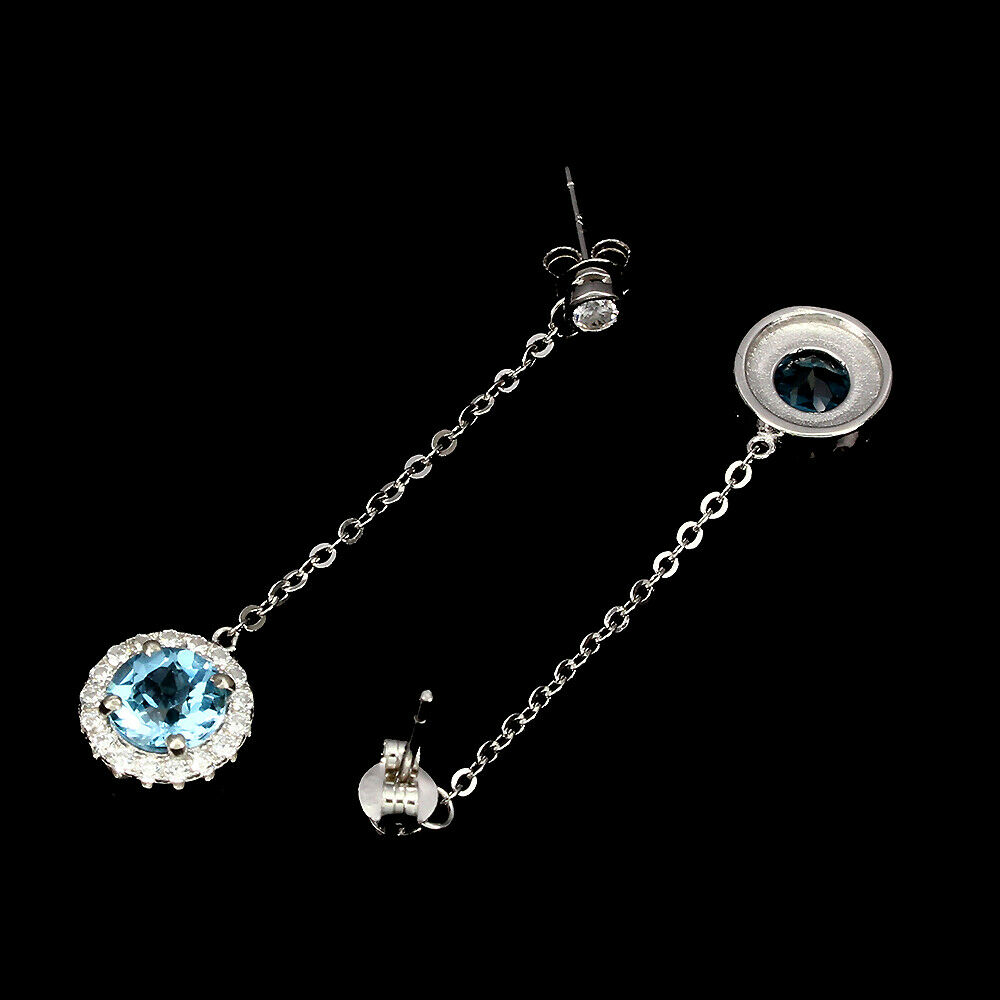 A pair of 925 silver drop earrings set with round cut Swiss blue topaz and white stones, L. 4.5cm. - Image 2 of 2