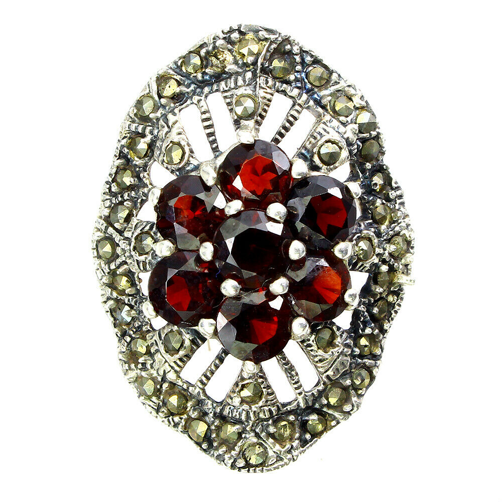 A 925 silver and marcasite ring set with garnets, (R).