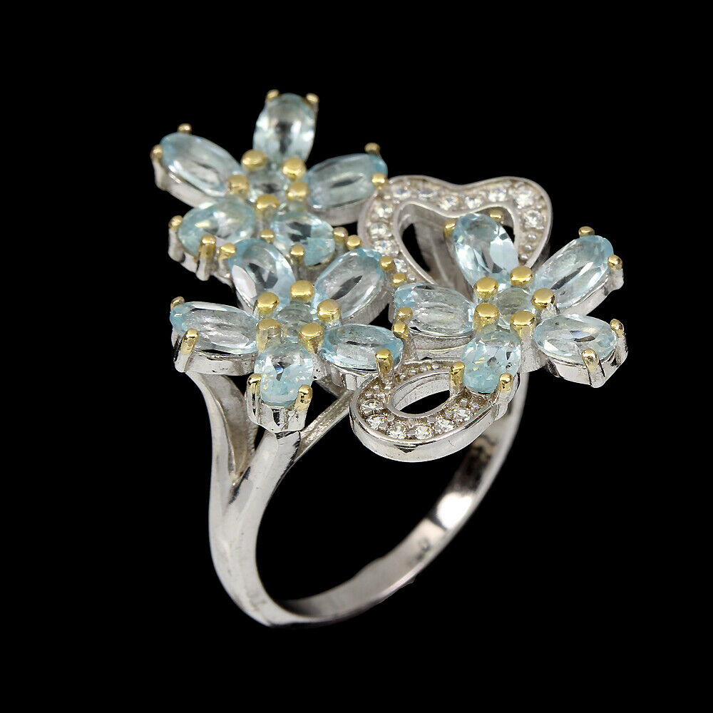 A 925 silver flower shaped ring set with oval cut blue topaz and white stones, (S). - Image 2 of 2