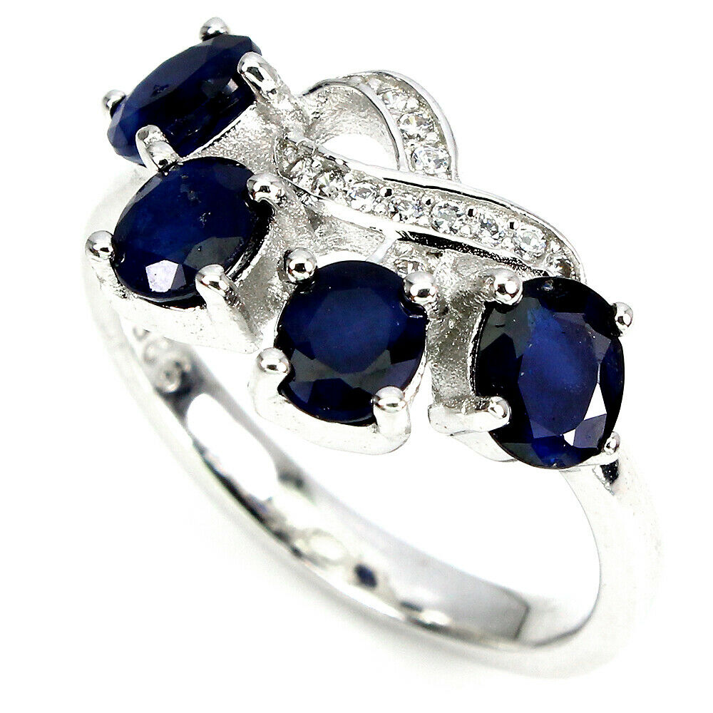 Lot 38 - A 925 silver ring set with sapphires and white stones, (M).