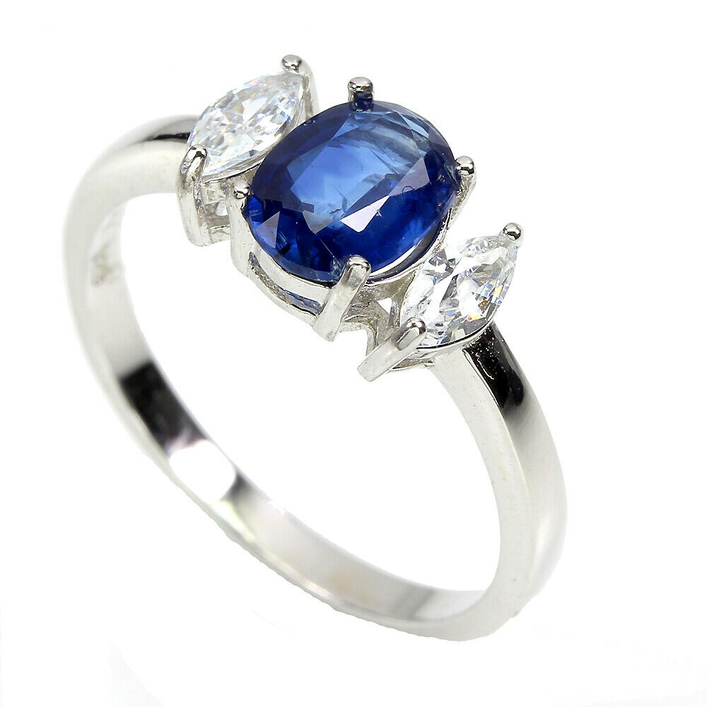 A 925 silver ring set with an oval cut sapphire and white stones, (S). - Image 2 of 2