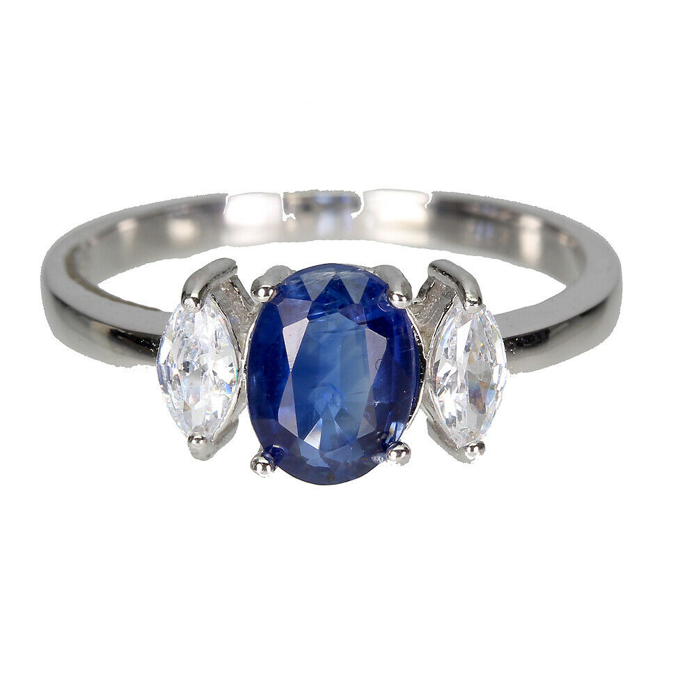 A 925 silver ring set with an oval cut sapphire and white stones, (S).
