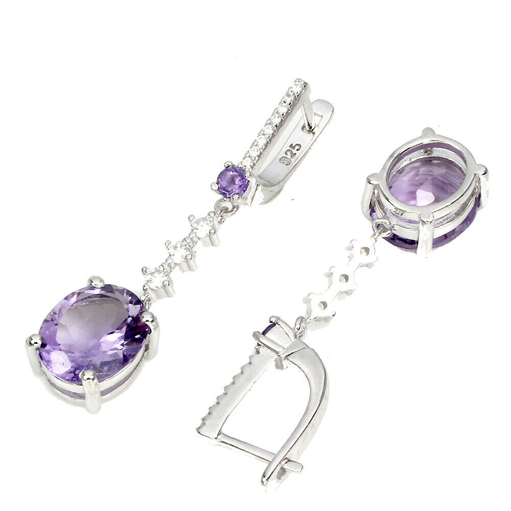 Lot 1 - A pair of 925 silver drop earrings set with oval cut amethysts and white stones, L. 4.3cm.