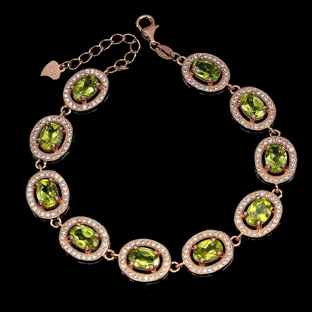 Lot 3 - A 925 silver rose gold gilt bracelet set with oval cut peridots and white stones, L. 19cm.