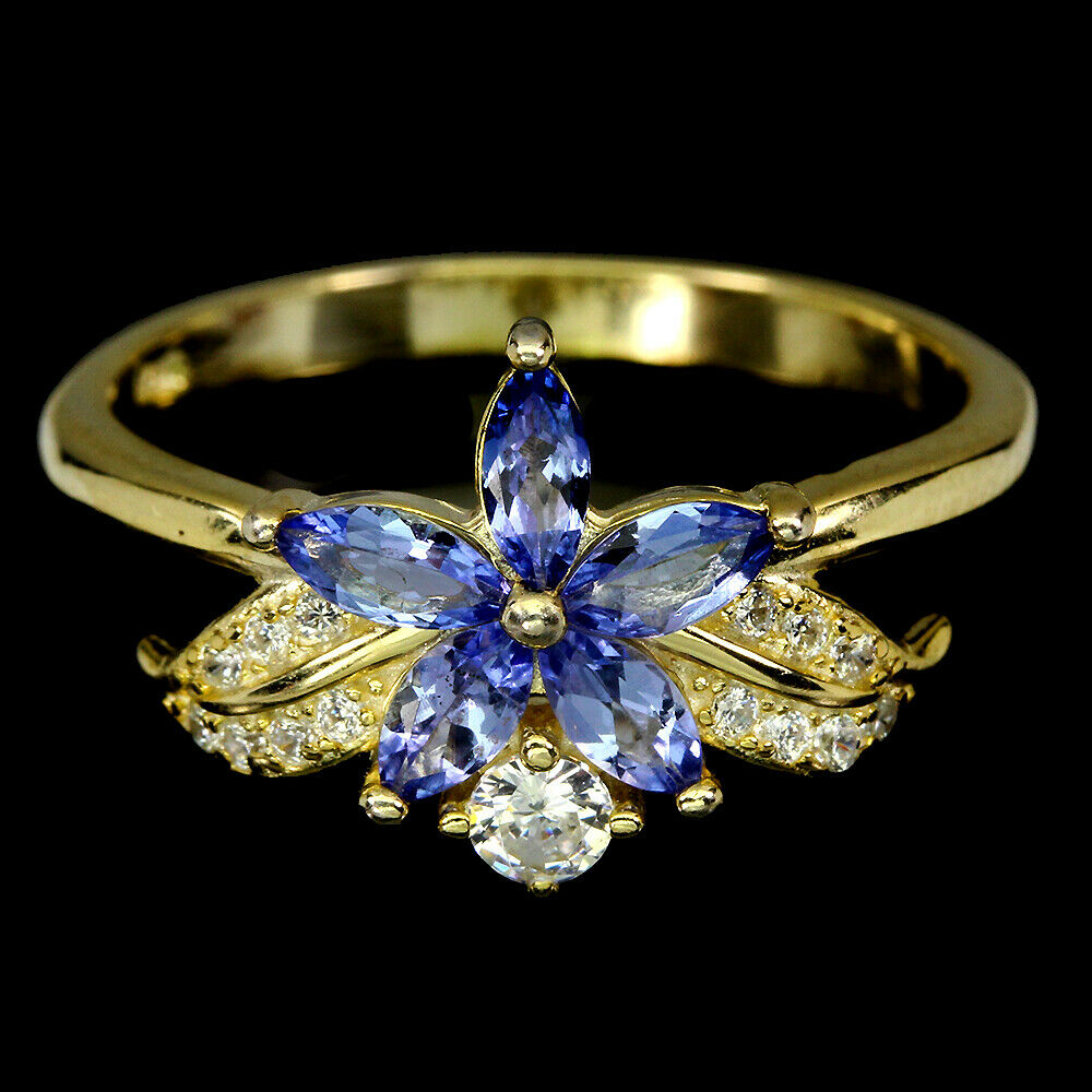 A 925 silver gilt flower shaped ring set with marquise cut tanzanites and white stones, (Q).