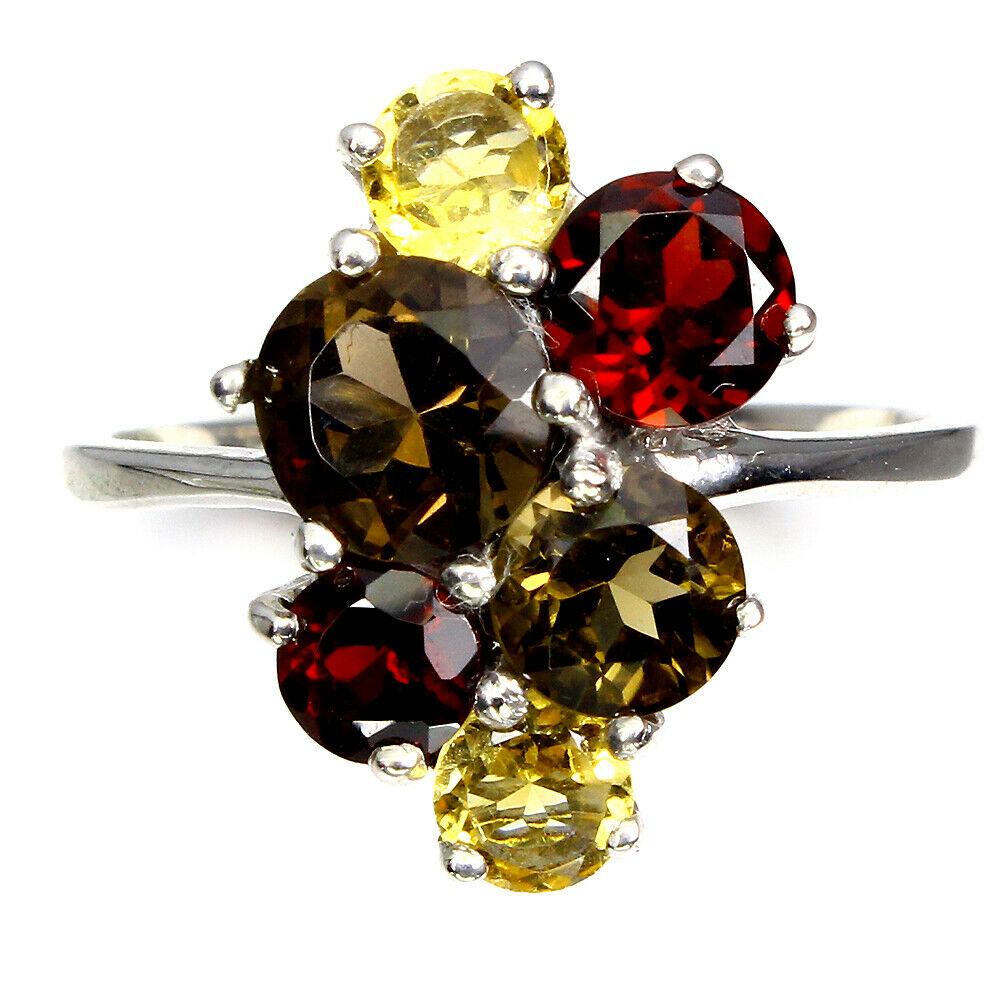 A 925 silver ring set with smokey quartz, citrine and garnets, (O).