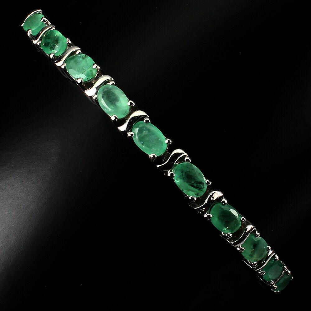 Lot 18 - A 925 silver adjustable bracelet set with oval cut emeralds.