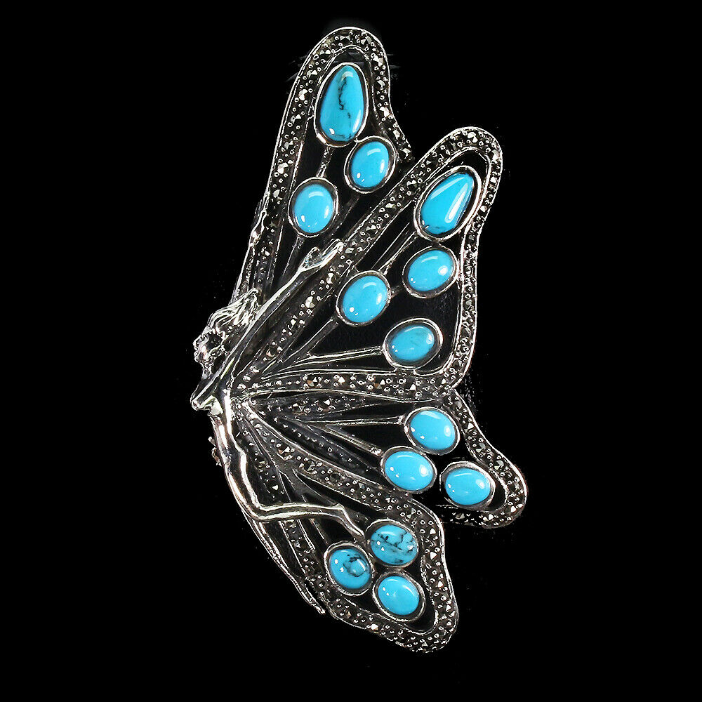 Lot 54 - A 925 silver and marcasite brooch set with turquoise, 7 x 3cm.
