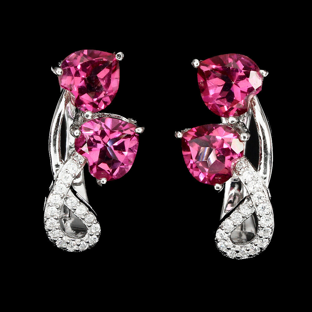Lot 41 - A pair of 925 silver earrings set with pink topaz and white stones, L. 2cm.