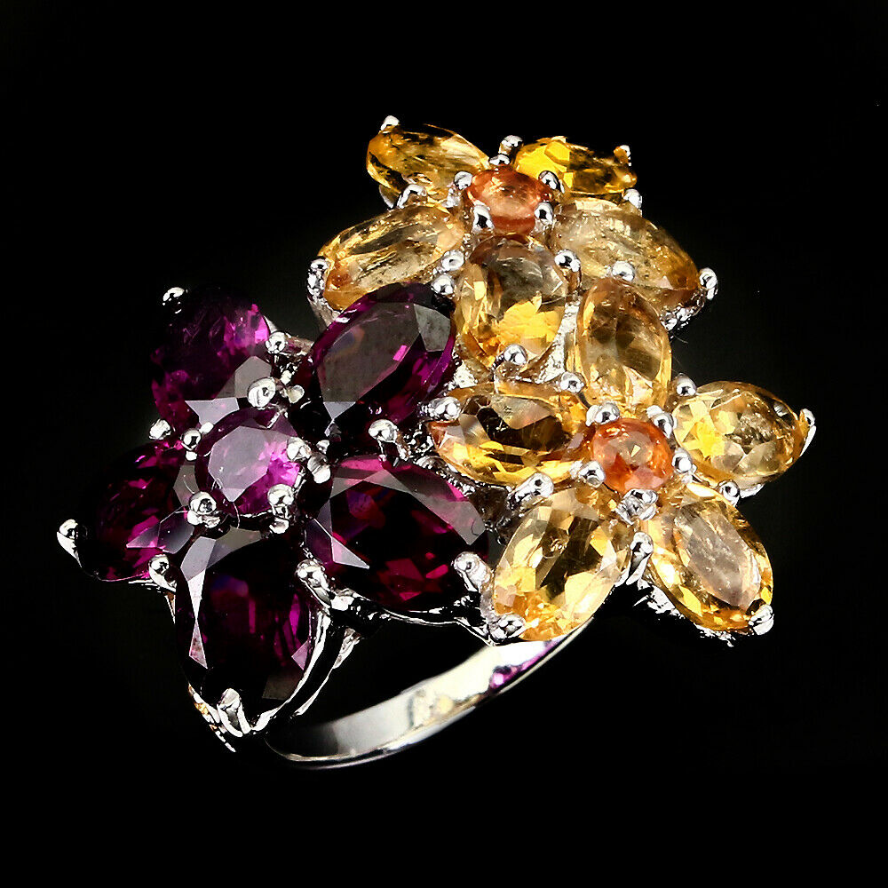 Lot 19 - A 925 silver flower shaped ring set with rodolite garnets and citrines, (N.5).