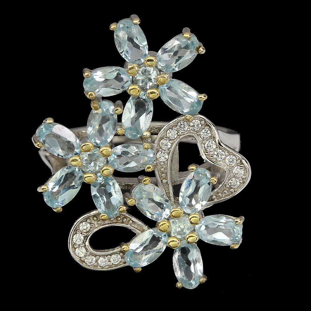 A 925 silver flower shaped ring set with oval cut blue topaz and white stones, (S).