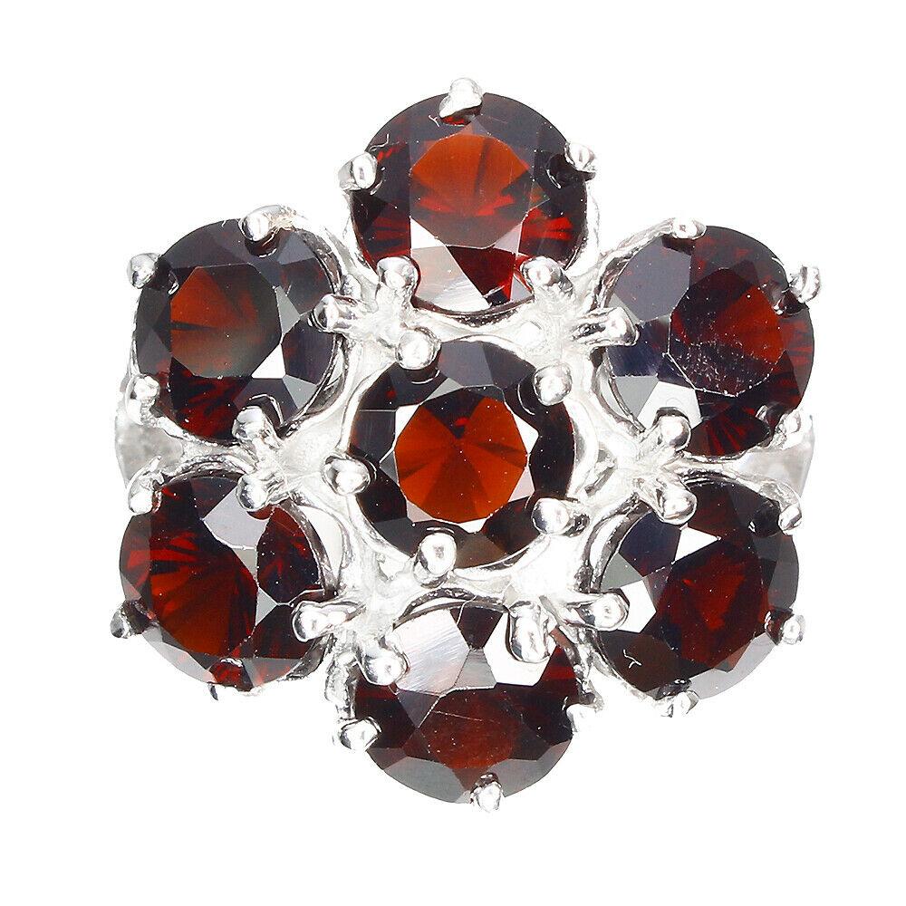 Lot 45 - A 925 silver garnet set cluster ring, (Q).