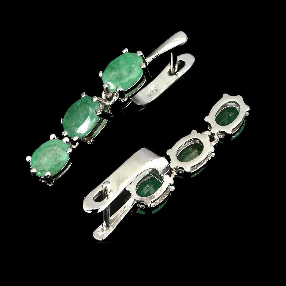 Lot 37 - A pair of 925 silver emerald set drop earrings, L. 3.5cm.