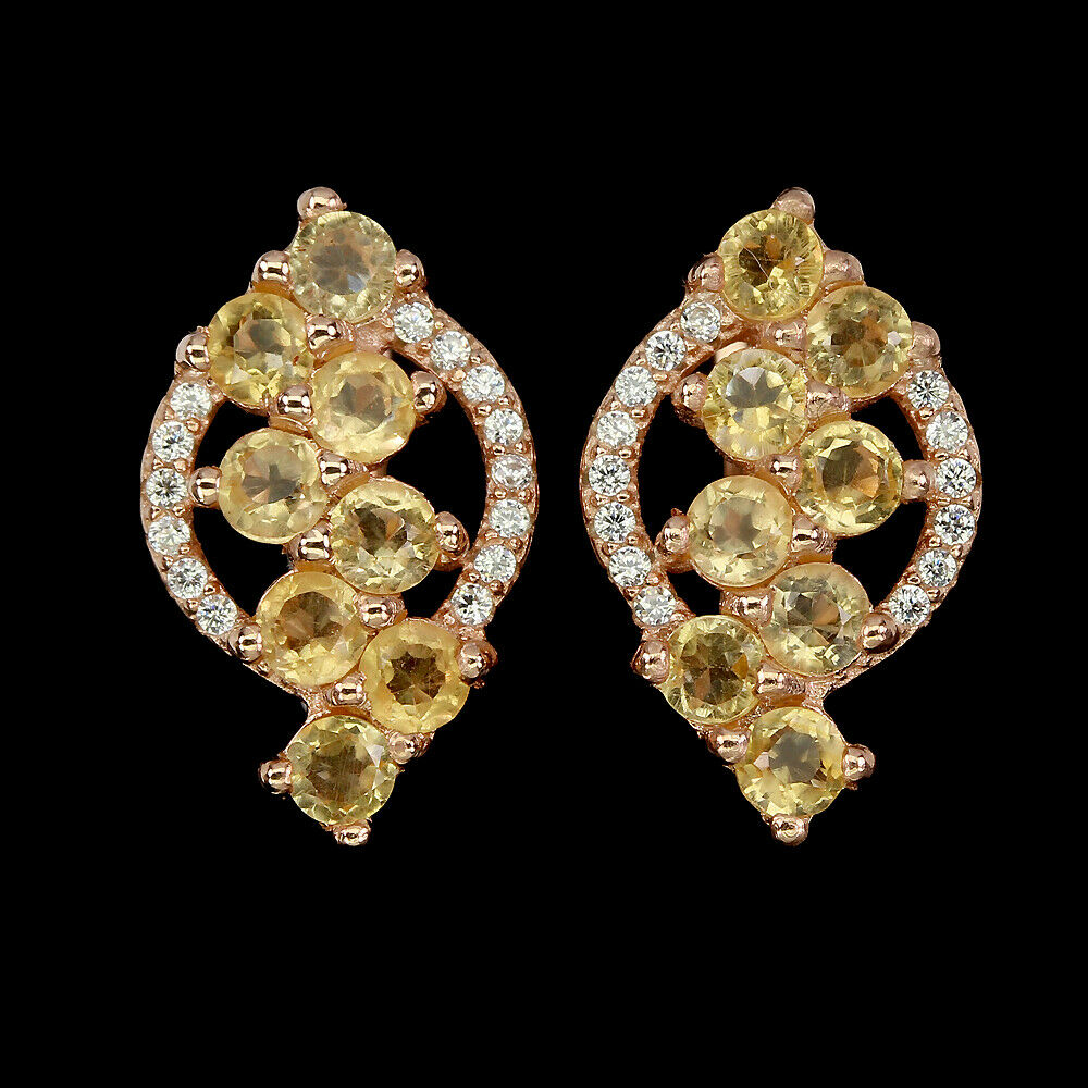 Lot 57 - A pair of 925 silver rose gold gilt drop earrings set with round cut citrines and white stones, L.