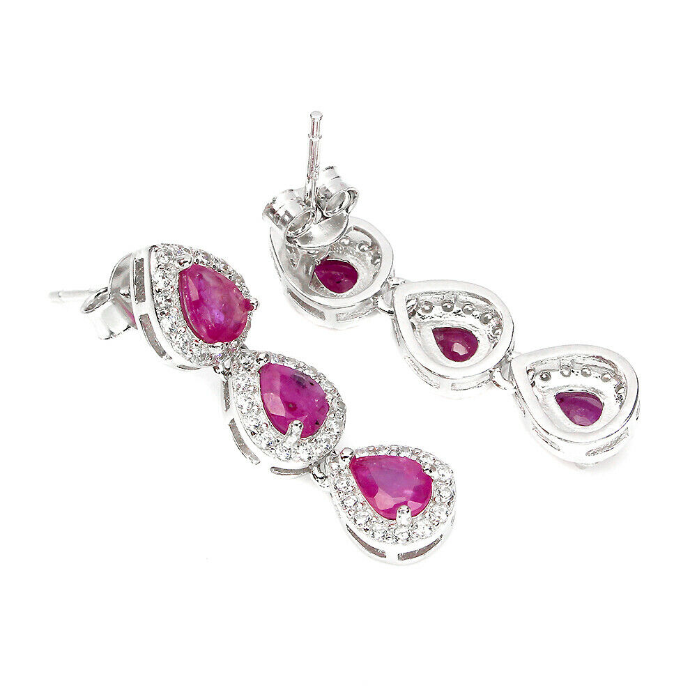 A pair of 925 silver drop earrings set with pear cut rubies and cubic zirconia, L. 2.5cm. - Image 2 of 2