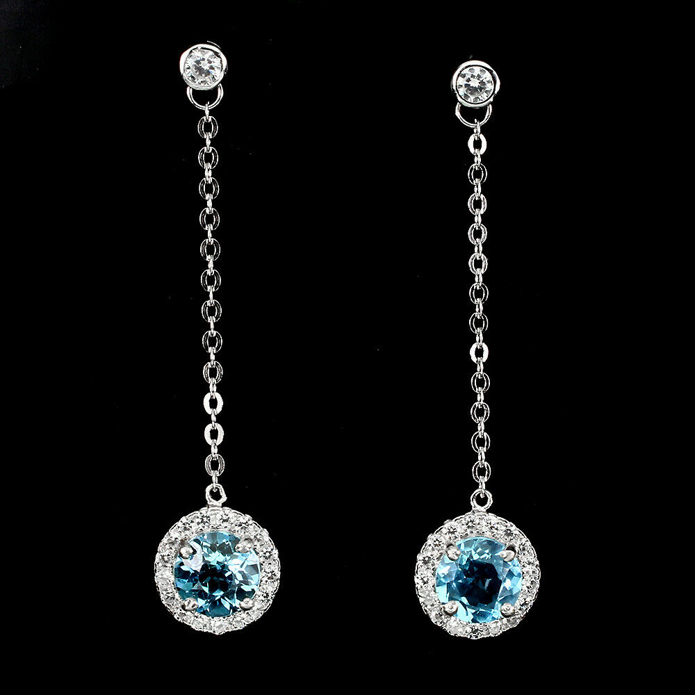 Lot 42 - A pair of 925 silver drop earrings set with round cut Swiss blue topaz and white stones, L. 4.5cm.