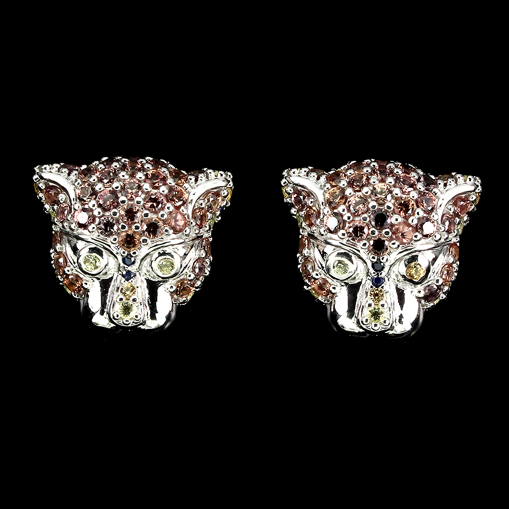 Lot 30 - A pair of 925 silver tiger head shaped stud earrings set with fancy yellow and orange sapphires,
