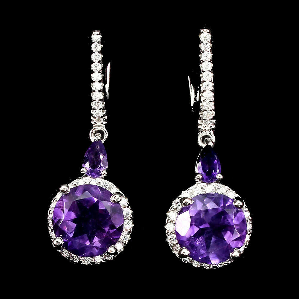 Lot 15 - A pair of 925 silver drop earrings set with round cut amethysts and white stones, L. 3.2cm.