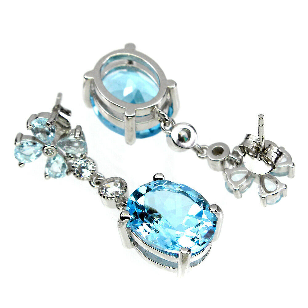 Lot 36 - A pair of 925 silver drop earrings set with aquamarines and oval cut Swiss blue topaz, L. 3cm.