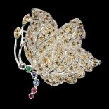 A 925 silver butterfly shaped brooch set with yellow sapphires, emerald, ruby and sapphires, 4 x 3.