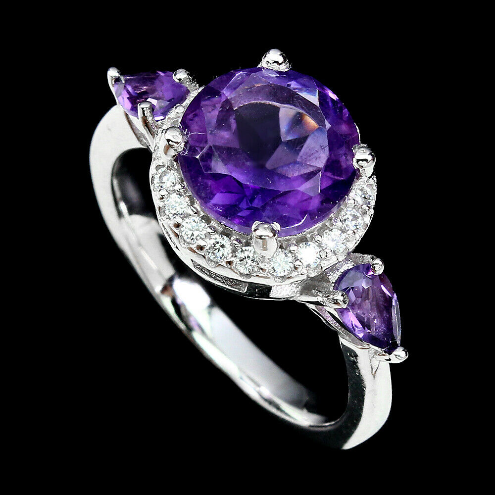 Lot 7 - A 925 silver ring set with round and pear cut amethysts, (M).