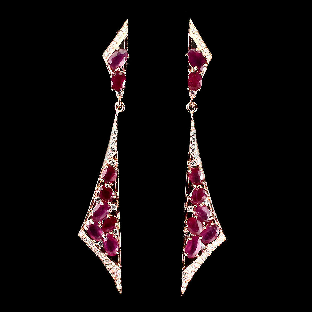 A pair of 925 silver rose gold gilt drop earrings set with oval cut rubies and white stones, L.