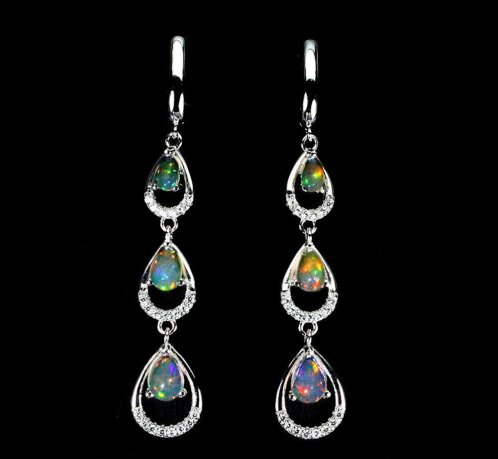 Lot 43 - A pair of 925 silver drop earrings set with cabochon cut opals and white stones, L. 5.5cm.