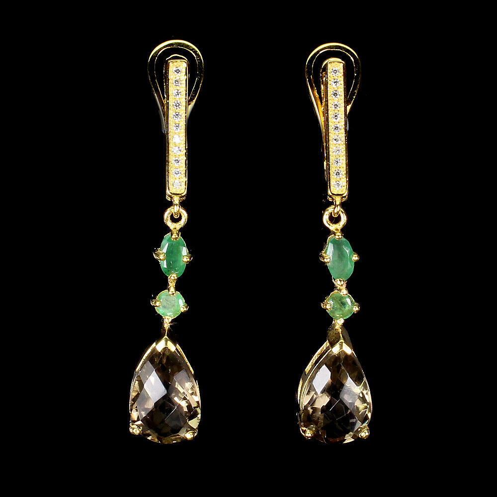 A pair of 925 silver gilt drop earrings set with a pear checker board cut smokey quartz and