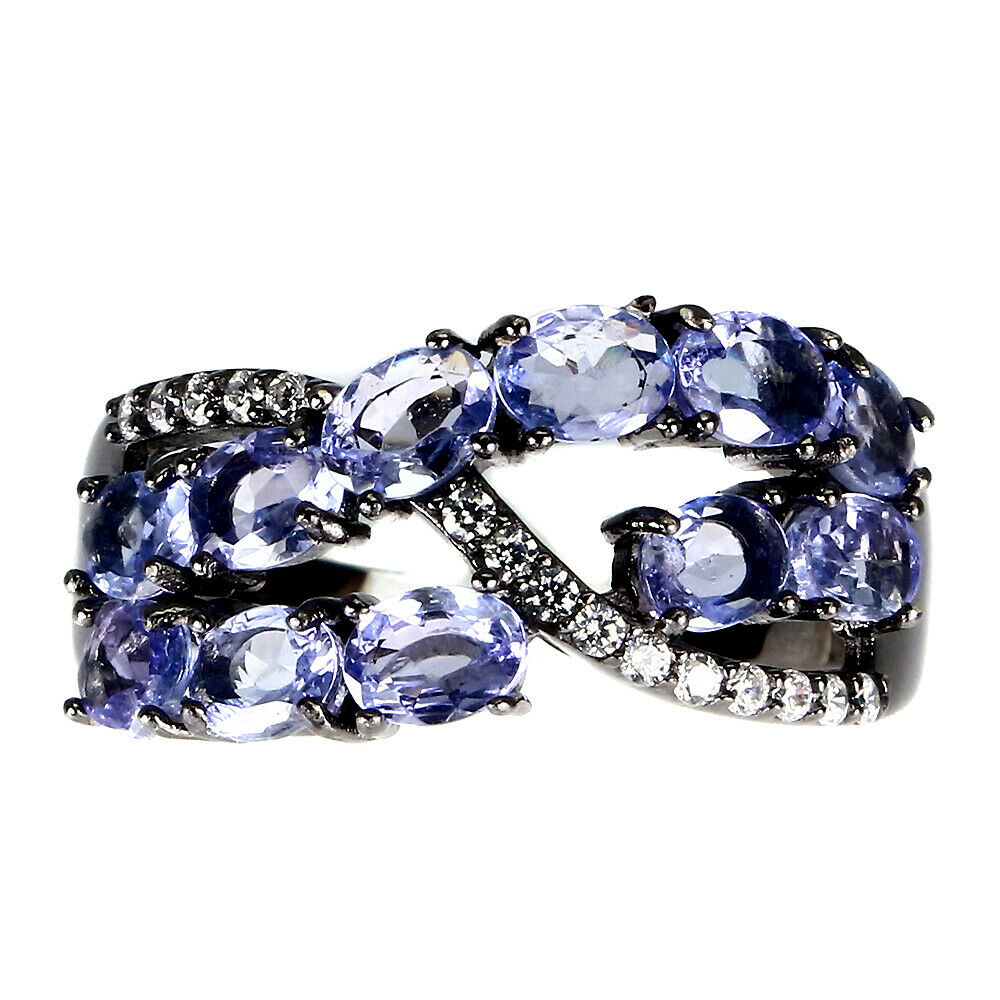 A 925 silver tanzanite and white stone set ring, (N.5).