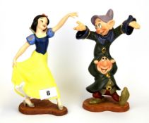 Two boxed porcelain figures from The Classics of Walt Disney collection - Snow White and The Seven
