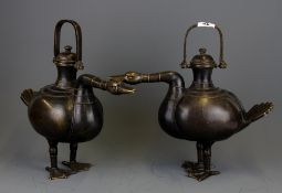 A superb pair of Chinese bronze goose shaped wine ewers, H. 34cm L. 39cm.