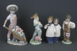 A Lladro porcelain figure of a child with a wheelbarrow filled with flowers and three further Nao
