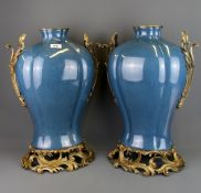 A pair of large continental ormolu mounted crackle glazed porcelain vases, H. 49.5cm.