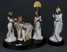 A group of Royal Worcester 'Court of Tutankhamun' limited edition (395/500) porcelain figures on a