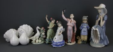 Five Lladro figurines and two Nao figurines, tallest H. 27cm.