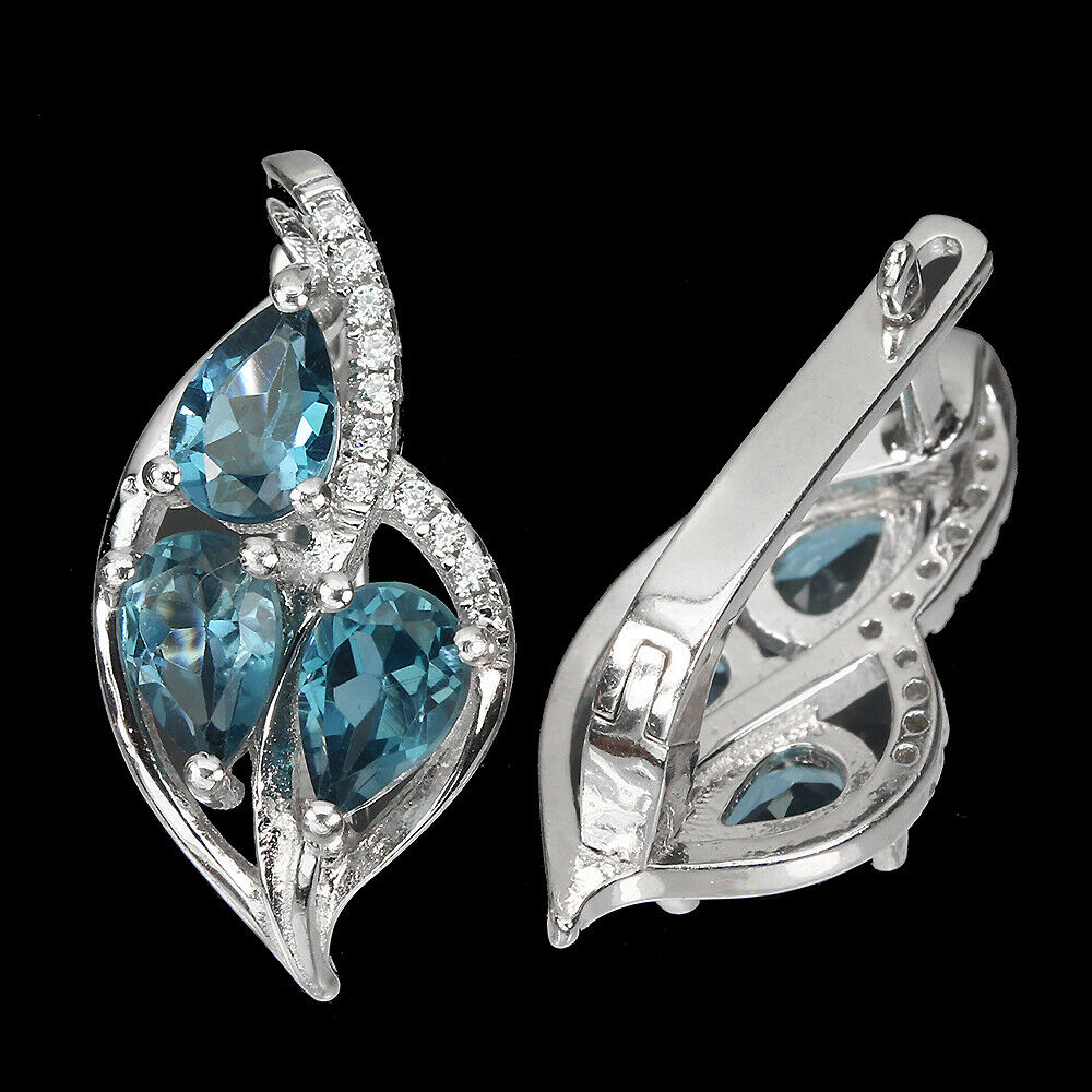 A pair of 925 silver earrings set with blue topaz and white stones, L. 2cm. - Image 2 of 2