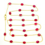 A 925 silver gilt necklace set with oval cut rubies, L. 90cm.