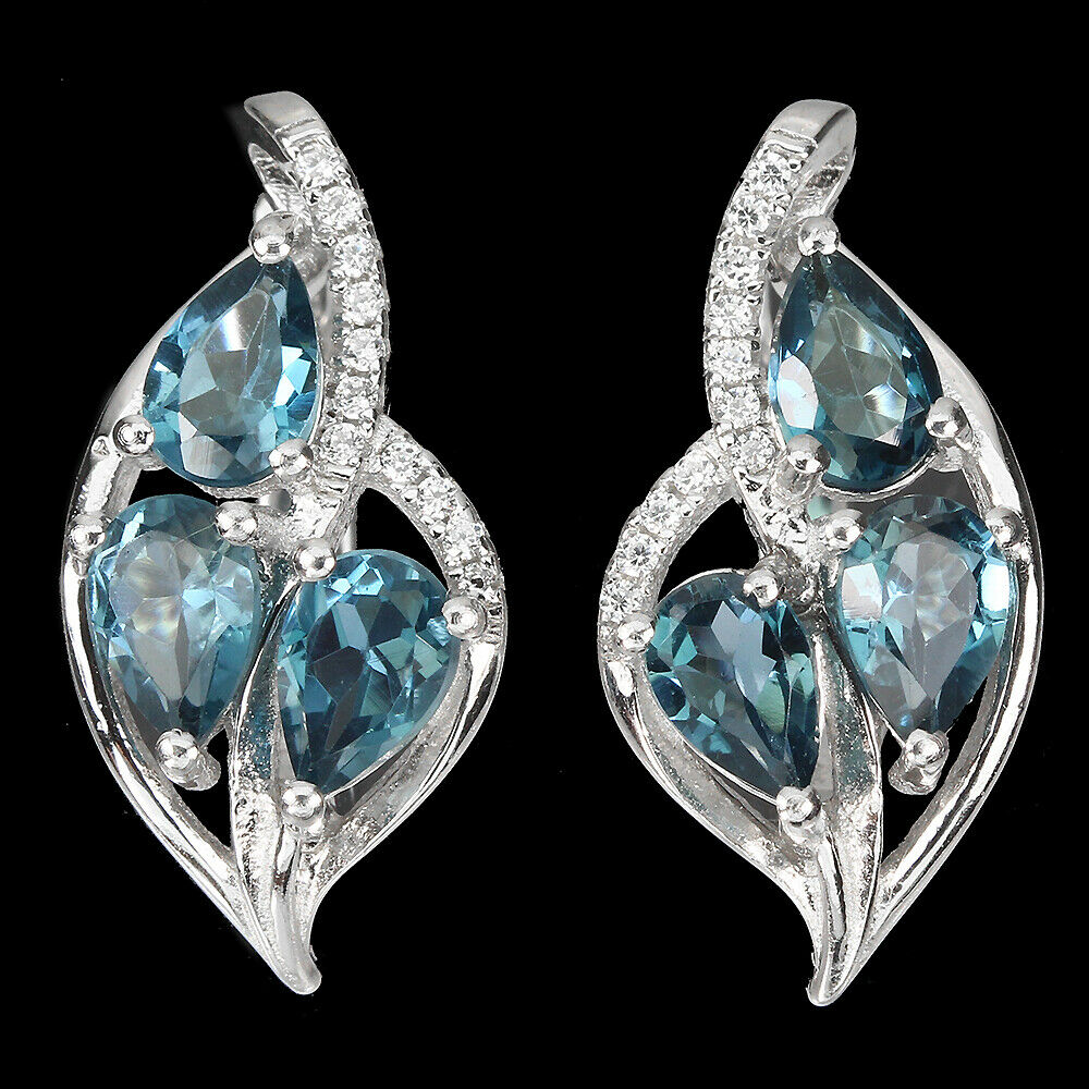 A pair of 925 silver earrings set with blue topaz and white stones, L. 2cm.