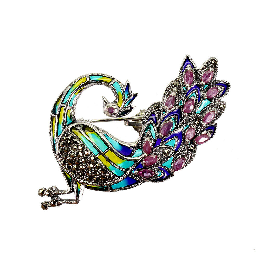 A peacock shaped 925 silver and marcasite enamelled brooch / pendant set with rubies, L. 6cm.